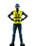 Construction worker standing safety vest silhouette. One  construction worker standing with safety vest silhouette isolated in white background Royalty Free Stock Photo