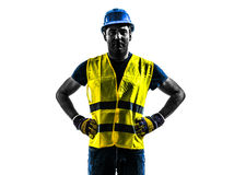 Construction worker standing safety vest silhouette. One construction worker standing with safety vest silhouette isolated in white background Royalty Free Stock Photos