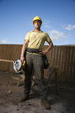 Construction Worker Standing with Saw Royalty Free Stock Photography