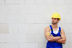 Construction worker standing at wall Stock Photography
