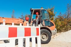 Construction worker starting road works on site Stock Photography