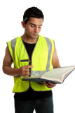 Construction worker or student. Construction worker with a book or a construction student apprentice studying learning. White backgrond royalty free stock image