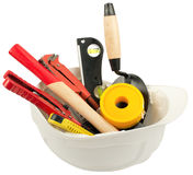 Construction worker supplies including hard hat Stock Photo