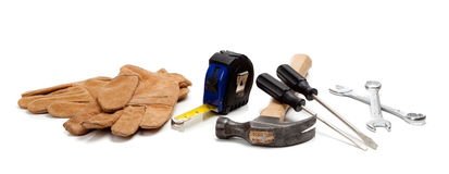 Construction worker supplies on white Royalty Free Stock Images