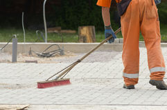 Construction worker sweeping Stock Photography