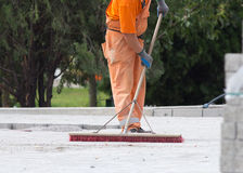 Construction worker sweeping Royalty Free Stock Images