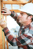 Construction Worker Takes Measurement Stock Image