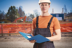 Construction worker taking notes. Construction worker takes notes from client Royalty Free Stock Images