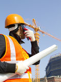 Construction worker with crane in background Stock Image