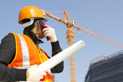 Construction worker with crane in background Stock Photography