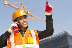 Construction worker with crane in background Stock Photo