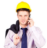 Construction worker talking on the phone Stock Image
