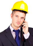 Construction worker talking on the phone Stock Images