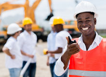 Construction worker talking on a radio Stock Photo