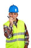 Construction worker talking with a walkie talkie Royalty Free Stock Images