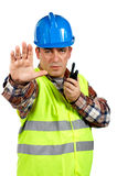 Construction worker talking with a walkie talkie and orders to s Stock Images