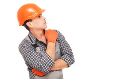 Construction worker thinking and looking away Royalty Free Stock Images