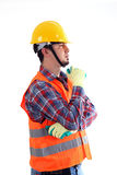 Construction Worker Thinking. With reflective jacket on the white background royalty free stock photo