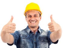 Construction worker with thumbs up. Portrait of a construction worker with hardhat making thumbs up sign Stock Photography