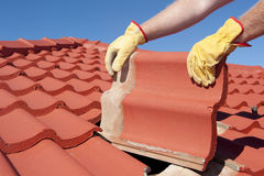 Construction worker tile house roofing repair Stock Photos