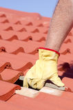 Construction worker tile roofing repair Royalty Free Stock Photo
