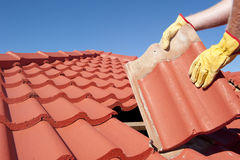 Construction worker tile roofing repair house Stock Photos