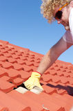 Construction worker tile roofing repairs stock images