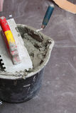 Construction worker is tiling at home tile floor adhesive Stock Photos