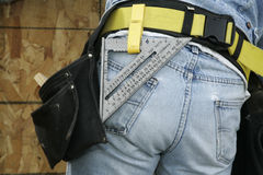 Construction Worker and Tool Belt. Tool belt on a construction worker Royalty Free Stock Image