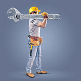 Construction worker with a tool belt and a wrench Stock Image