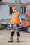 Construction worker with tool box Royalty Free Stock Photo