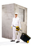 Construction worker with tools and cement wall on white backgrou Royalty Free Stock Images