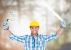 Construction Worker with tools in front of construction site. Digital composite of Construction Worker with tools in front of construction site Stock Photography