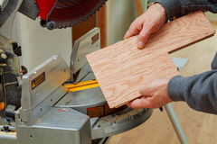Construction worker, Trimming parquet on using circular miter saw cutting Royalty Free Stock Photography