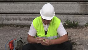 Construction worker trying to smoke stock footage