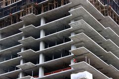 Construction Worker on Unfinished Highrise. A construction worker on an unfinished highrise building Royalty Free Stock Image