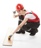 Construction worker in uniform with laminate Stock Photography