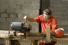 Construction Worker Uses Chopsaw - Horizontal Royalty Free Stock Images
