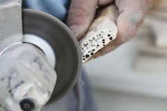 Construction worker using an angle grinder cutting tile Royalty Free Stock Photos