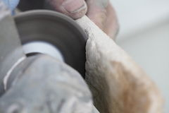 Construction worker using an angle grinder cutting tile Royalty Free Stock Photo