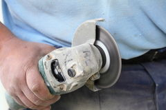 Construction worker using an angle grinder cutting tile Stock Photo