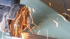 Construction Worker Using An Angle Grinder. Producing a lot of sparks stock video footage
