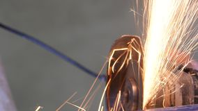 Construction Worker Using An Angle Grinder. Producing a lot of sparks stock footage