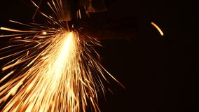 Construction Worker Using An Angle Grinder. Producing a lot of sparks stock video