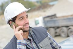 Construction worker using cell phone. Construction Royalty Free Stock Photos
