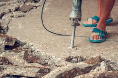 Construction worker using concrete drilling machine in construct Royalty Free Stock Photography