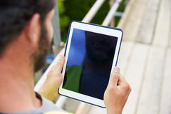 Construction Worker Using Digital Tablet On Building Site Stock Photo