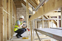 Construction Worker Using Drill On House Build Stock Images