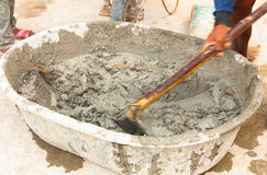 Construction worker during using hoe to mix wet cement Stock Images