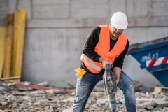 Construction worker using a jackhammer. Male construction worker using a jackhammer on construction site Royalty Free Stock Photo